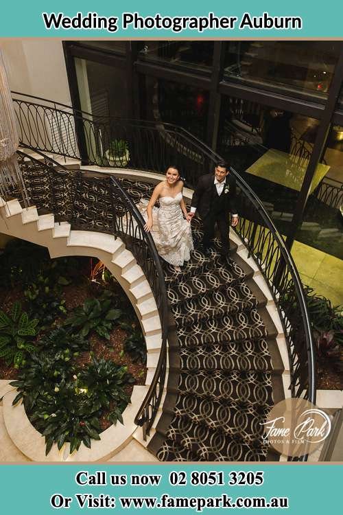 Photo of the Bride and the Groom going down the stair Auburn NSW 2144