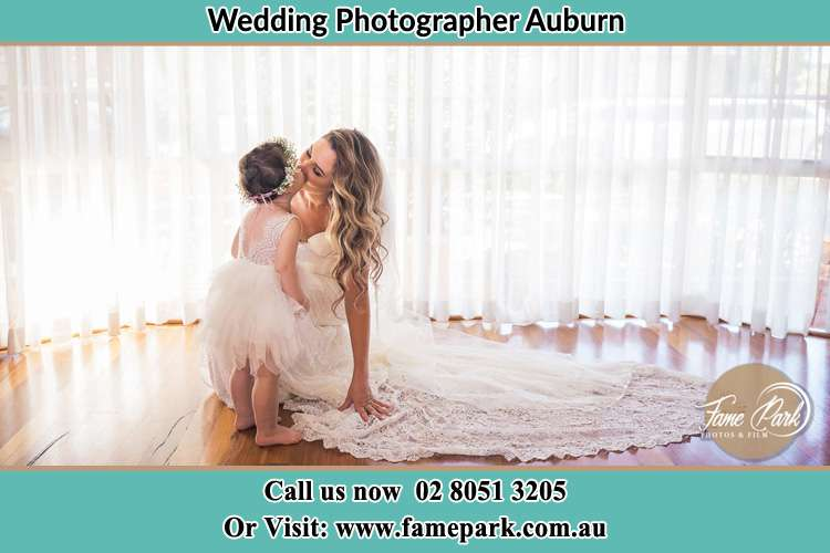 Photo of the Bride kiss the flower girl Auburn NSW 2144