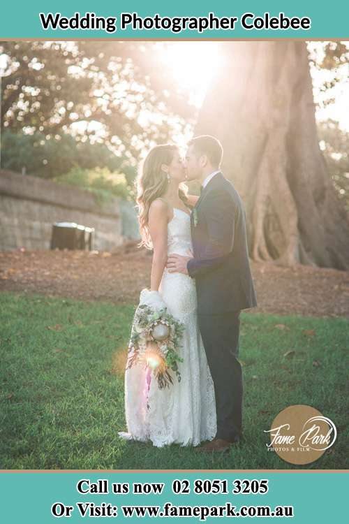Photo of the Bride and the Groom kissing at the garden Colebee NSW 2761