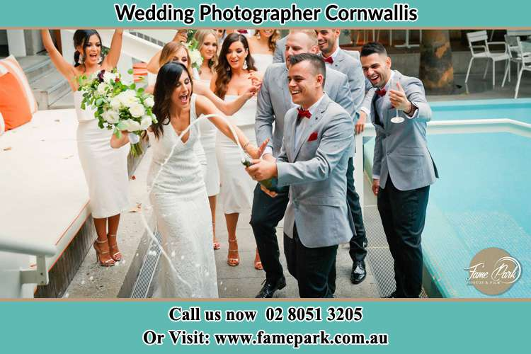 Photo of the Groom and the Bride celebrating with the secondary sponsors Cornwallis NSW 2756