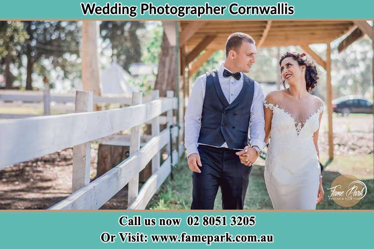 Photo of the Groom and the Bride holding hands while walking Cornwallis NSW 2756