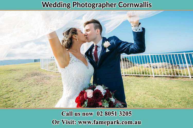 Photo of the Bride and the Groom kissing at the yard Cornwallis NSW 2756