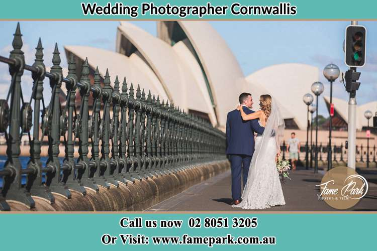 The Groom and the Bride walking towards the Sydney Grand Opera House Cornwallis NSW 2756