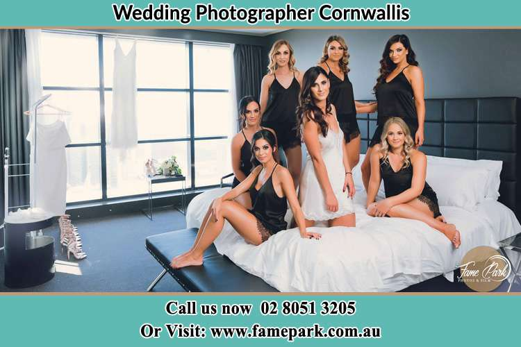 Photo of the Bride and the bridesmaids wearing lingerie on bed Cornwallis NSW 2756