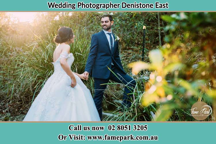 Photo of the Bride and the Groom going up the hill Denistone East NSW 2112
