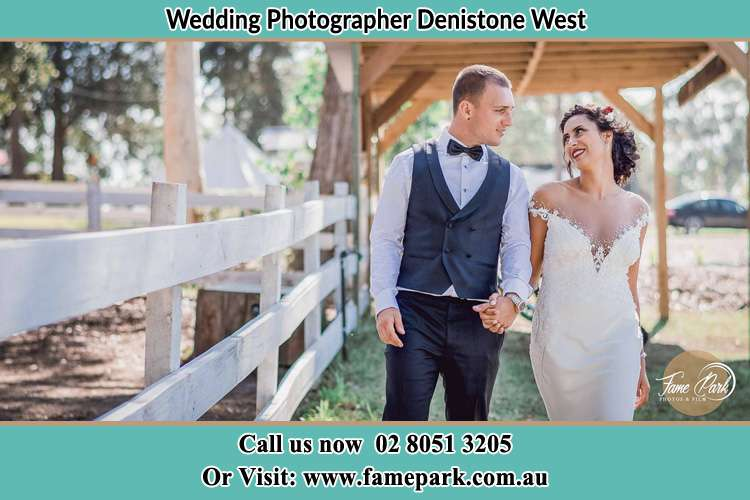 Photo of the Groom and the Bride holding hands while walking Denistone West NSW 2114
