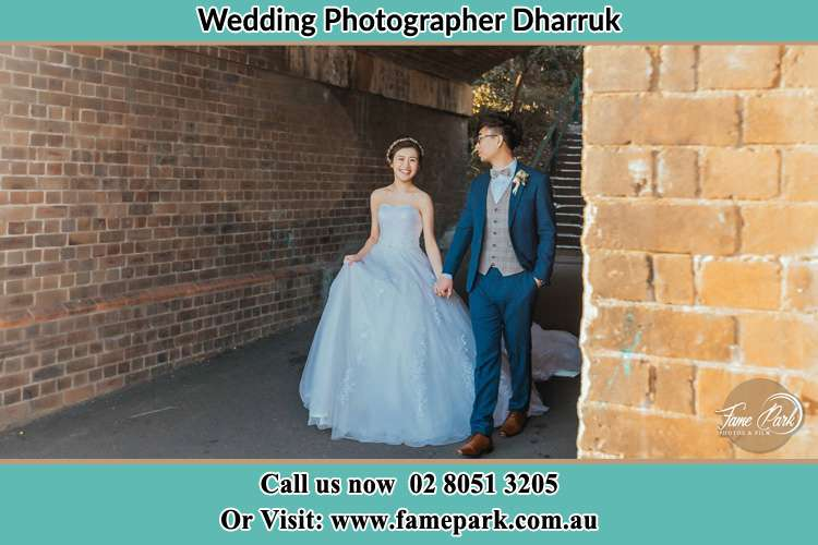 Photo of the Bride and the Groom walking Dharruk NSW 2770