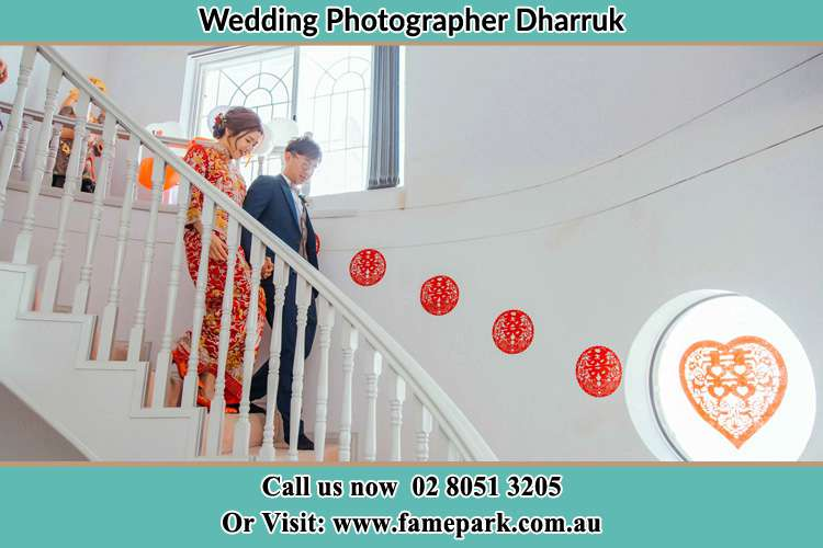 Photo of the Bride and the Groom going down the stair Dharruk NSW 2770