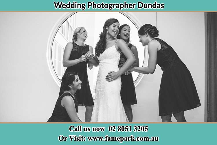 Photo of the Bride and the bridesmaids near the window Dundas NSW 2117
