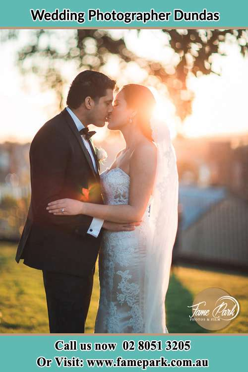 Photo of the Groom and the Bride kissing at the yard Dundas NSW 2117