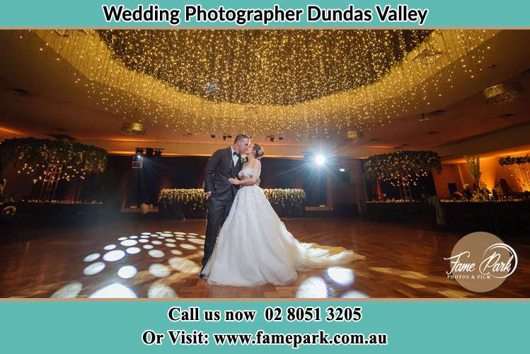 Photo of the Groom and the Bride kissing on the dance floor Dundas Valley NSW 2117