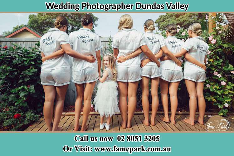 Behind photo of the Bride and the bridesmaids with the flower girl looking back Dundas Valley NSW 2117