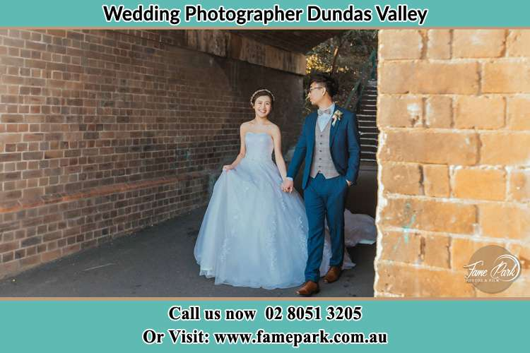 Photo of the Bride and the Groom walking Dundas Valley NSW 2117