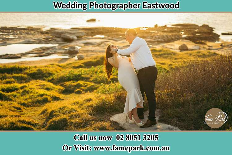 Photo of the Bride and the Groom dancing near the lake Eastwood NSW 2122