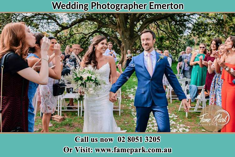 Photo of the Bride and the Groom showering bubbles by the visitors Emerton NSW 2770