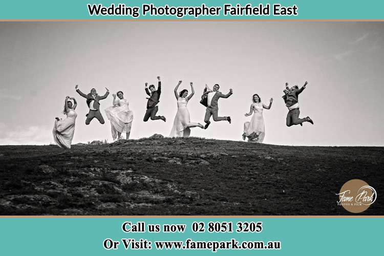 Jump shot photo of the Groom and the Bride with the entourage Fairfield East NSW 2165