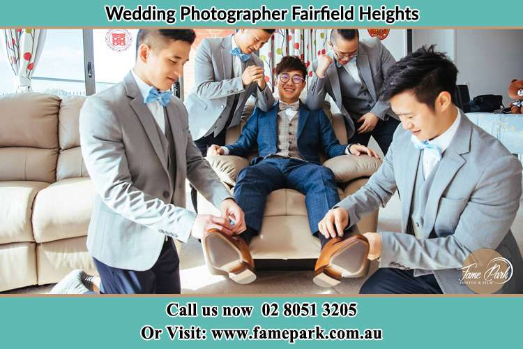 Photo of the Groom helping by the groomsmen getting ready Fairfield Heights NSW 2165