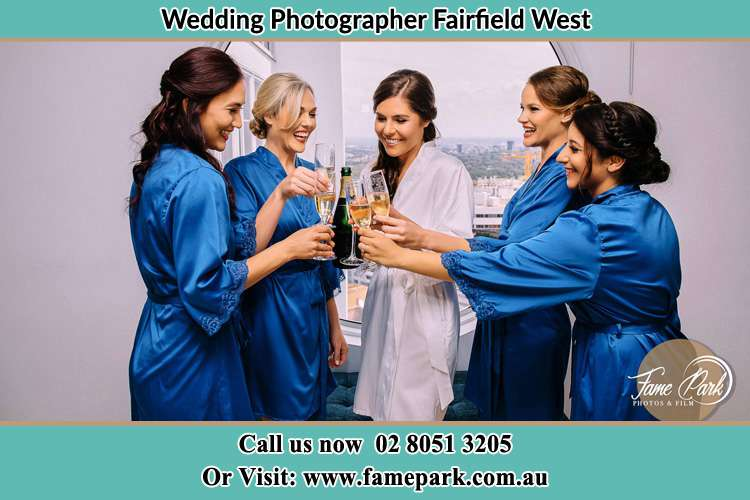 Photo of the Bride and the bridesmaids having wine Fairfield West NSW 2165