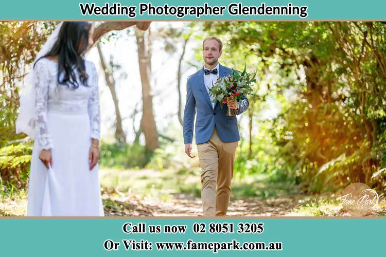 Photo of the Groom bringing flower to the Bride Glendenning NSW 2761