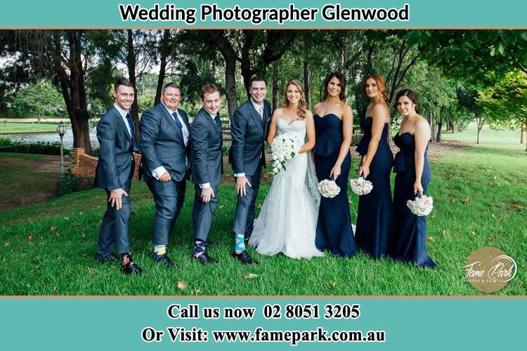 The Bride and the Groom with their entourage pose for the camera Glenwood NSW 2768