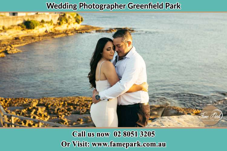 Photo of the Bride and the Groom hugging near the lake Greenfield Park NSW 2176