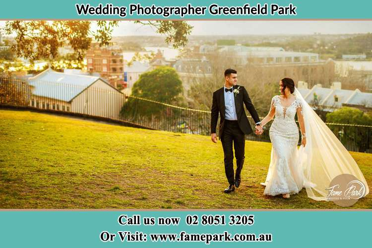 Photo of the Groom and the Bride walking at the yard Greenfield Park NSW 2176