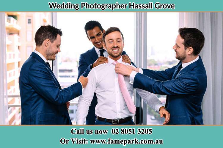 Photo of the Groom helping by the groomsmen getting ready Hassall Grove NSW 2761