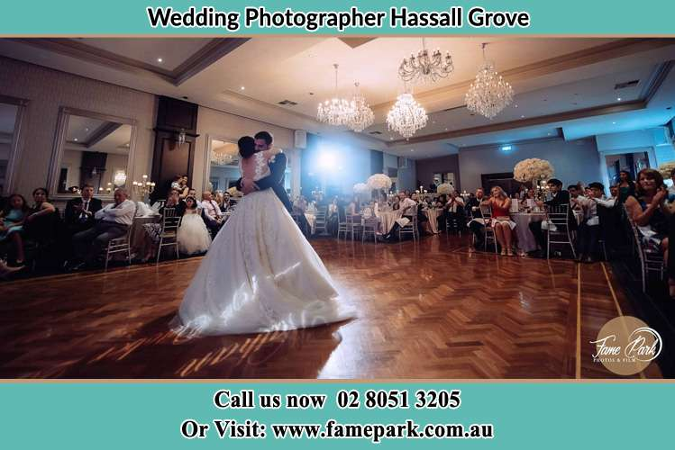 Photo of the Bride and the Groom hugging on the dance floor Hassall Grove NSW 2761