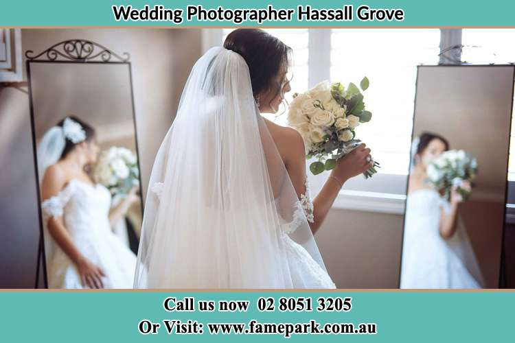 Photo of the Bride holding flower at the front of the mirrors Hassall Grove NSW 2761