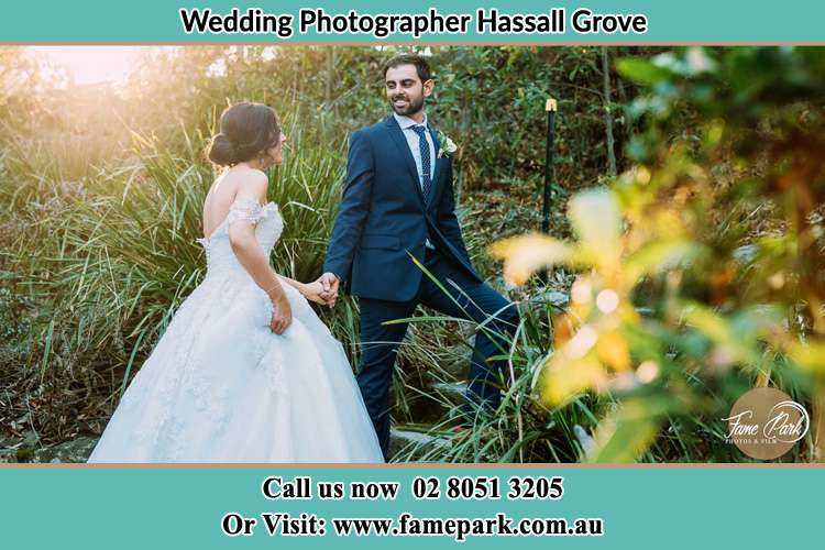 Photo of the Groom and the Bride going up the hill Hassall Grove NSW 2761