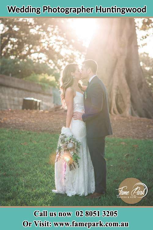 Photo of the Bride and the Groom kissing at the yard Huntingwood NSW 2148