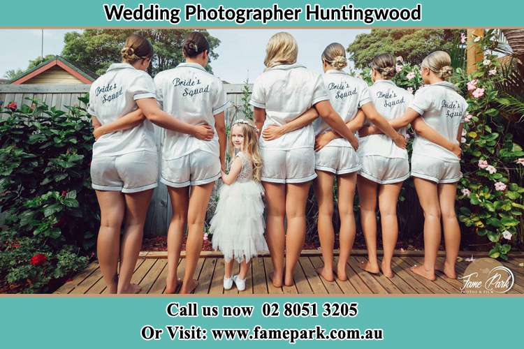 Behind photo of the Bride and the bridesmaids with the flower girl looking back Huntingwood NSW 2148