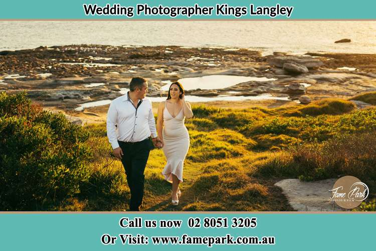 Photo of the Groom and the Bride walking near the lake Kings Langley NSW 2147