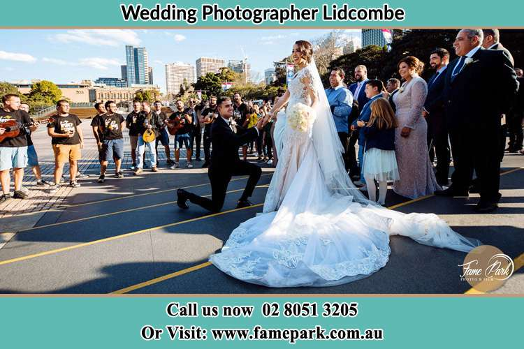 Groom Kneeling down in front of the Bride Lidcombe NSW 2141