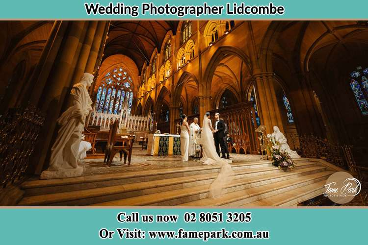 Photo of the Bride and the Groom at the altar Lidcombe NSW 2141