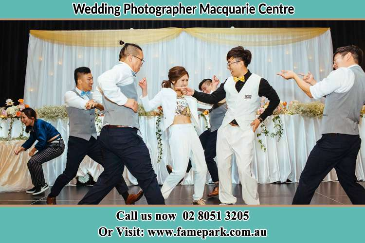Photo of the Bride and the Groom dancing with the bridesmaids Macquarie Centre NSW 2113
