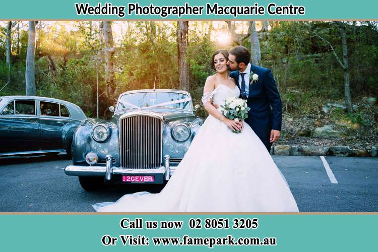 Photo of the Bride and the Groom at the front of the bridal car Macquarie Centre NSW 2113