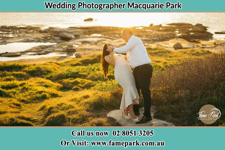 Photo of the Bride and the Groom dancing near the lake Macquarie Park NSW 2113