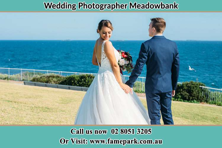 Photo of the Bride and the Groom holding hands at the yard Meadowbank NSW 2114