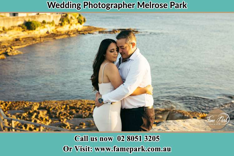 Photo of the Bride and the Groom hugging near the lake Melrose Park NSW 2114
