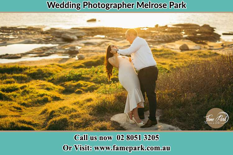 Photo of the Bride and the Groom dancing near the lake Melrose Park NSW 2114