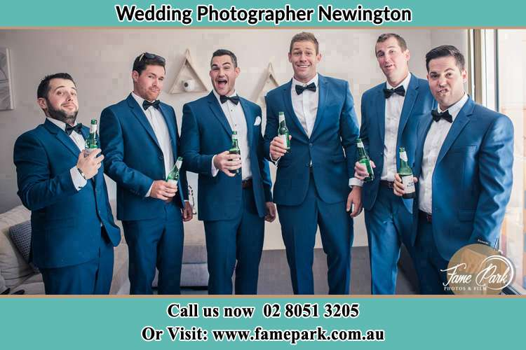 The groom and his groomsmen striking a wacky pose in front of the camera Newington NSW 2127