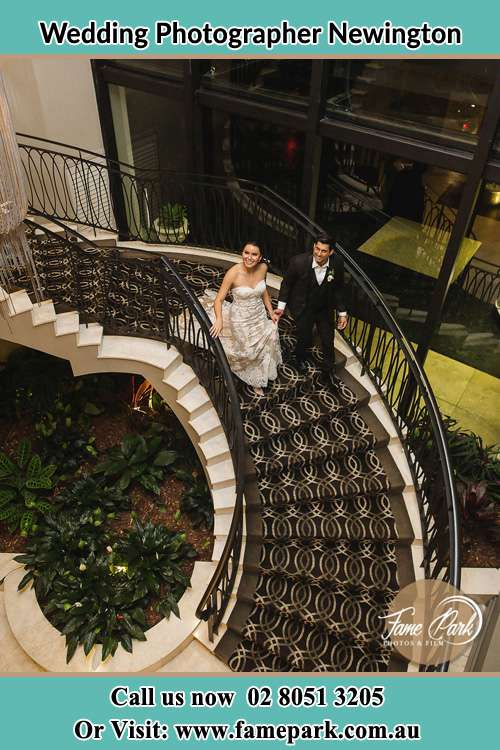 Photo of the Bride and the Groom going down the stair Newington NSW 2127