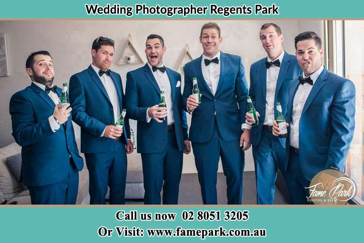 The groom and his groomsmen striking a wacky pose in front of the camera Regents Park NSW 2143