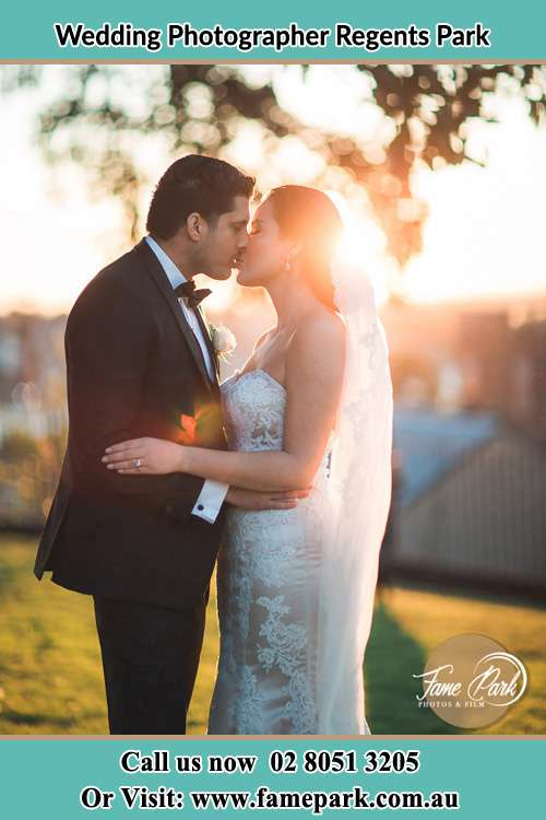 Photo of the Groom and the Bride kissing at the yard Regents Park NSW 2143
