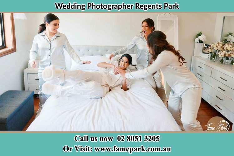 Photo of the Bride and the bridesmaids playing on bed Regents Park NSW 2143