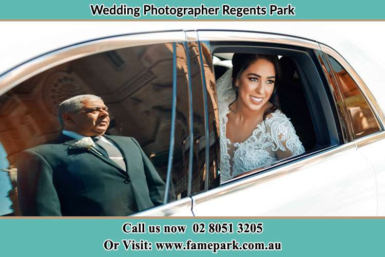 Photo of the Bride inside the bridal car with her father standing outside Regents Park NSW 2143