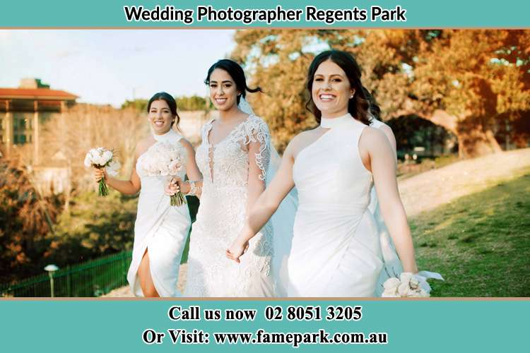 Photo of the Bride and the bridesmaids walking Regents Park NSW 2143