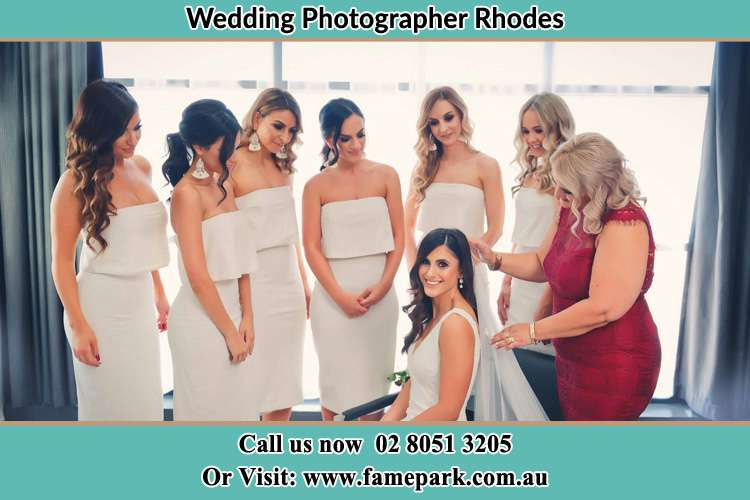 Photo of the Bride and the secondary sponsor preparing Rhodes NSW 2138