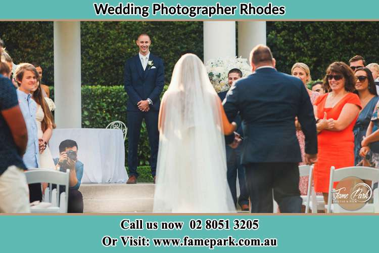 Photo of the Bride with her father walking the aisle Rhodes NSW 2138